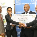 Chairman of the Jamaica International Invitational Meet (JIIM) Organising Committee, Dr Warren Blake (right) and Vice Chairman, Ludlow Watts (second right) are thrilled to accept a $6 million sponsorship contribution from Camille Taylor, (second left) the Petroleum Corporation of Jamaica's (PCJ) Manager, Information & Corporate Affairs; while Meet Director, Mr. Donald Quarrie carefully inspects the sponsorship cheque.  The PCJ and its subsidiaries PETCOM and Wigton Windfarm Limited responded to an appeal from the organisers for support to stage the prestigious meet which is scheduled for May 3 at the National Stadium.  The contribution was handed over today at the PCJ's office in New Kingston.